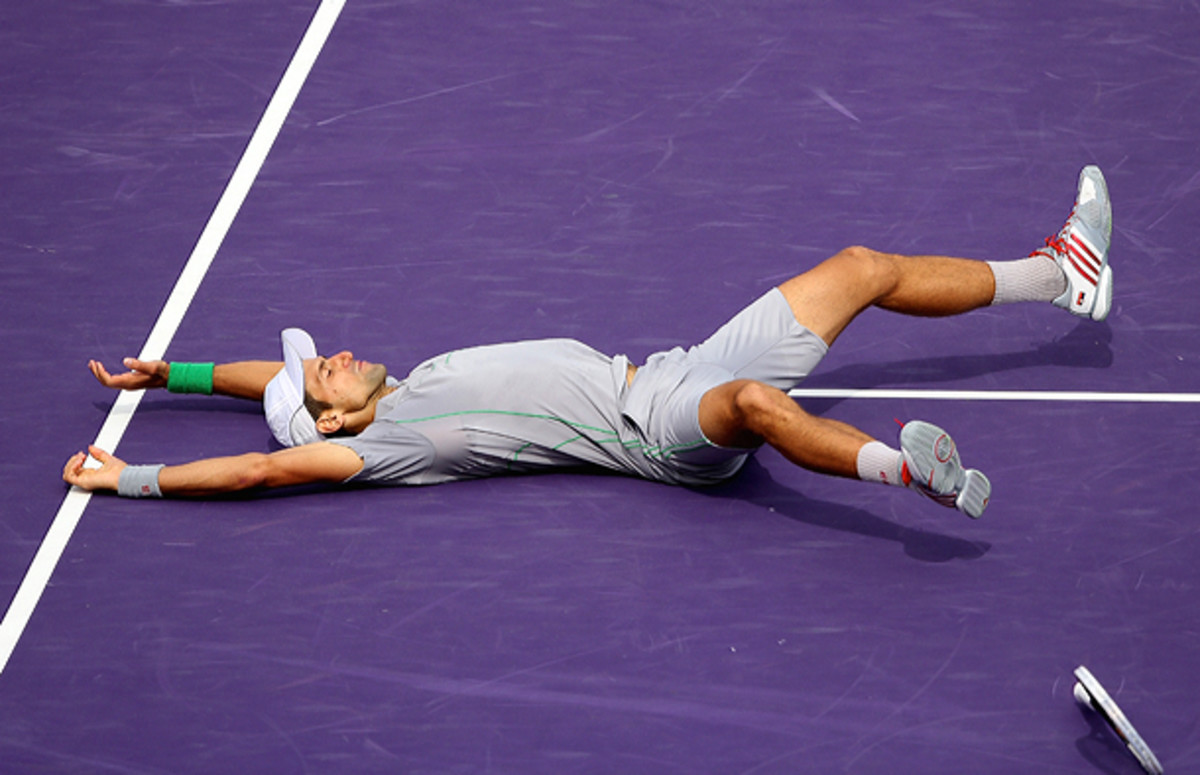 Novak Djokovic celebrates after winning his fourth Sony Open title.