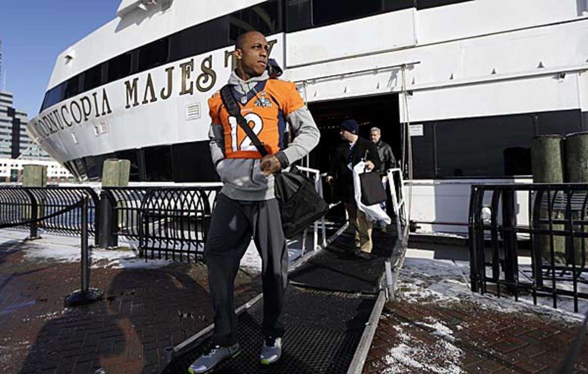 Andre Caldwell heads off the yacht where the Broncos are attending news conferences. (Mark Humphrey/AP)