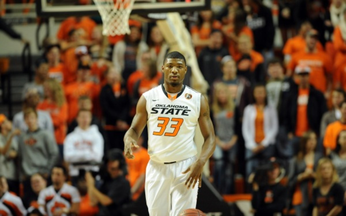 OSU guard Marcus Smart is averaging 20 points and four rebounds this season. (AP Photo/Brody Schmidt)