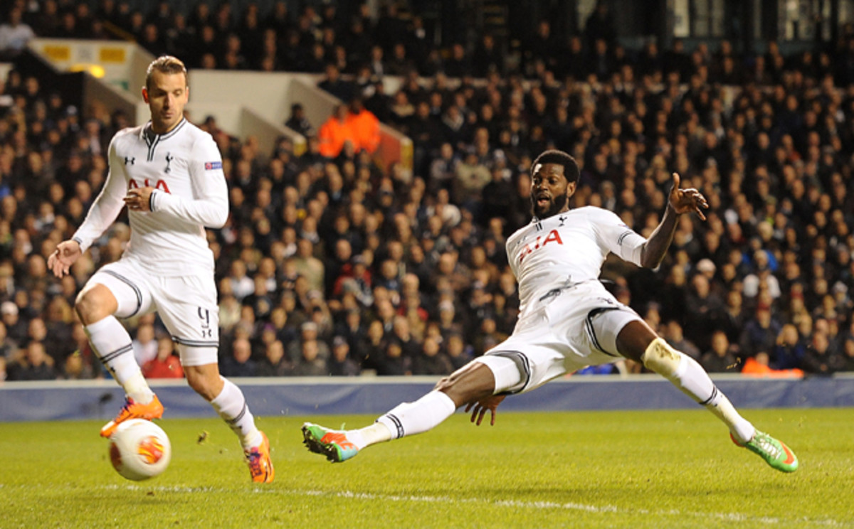 Tottenham's Emmanuel Adebayor, right, extends for a goal in Spurs' Europa League triumph over Dnipro on Thursday.