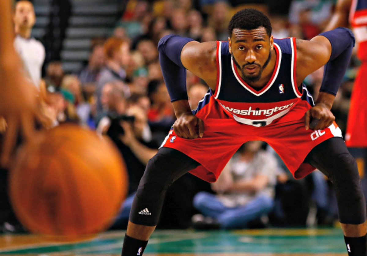 John Wall and the Wizards have come to hang their hat on defense. (Jared Wickerham/Getty Images)