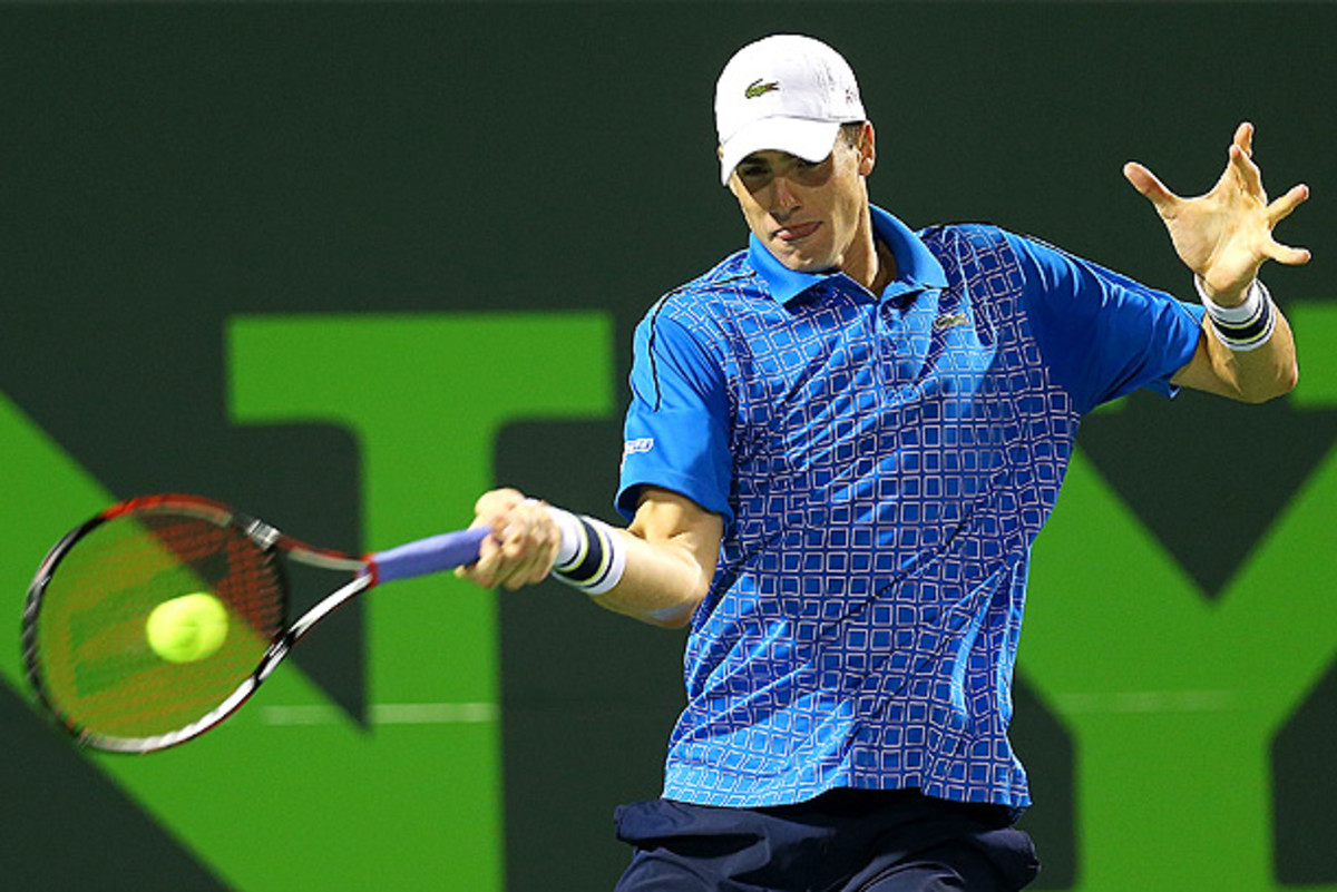 John Isner beat Nicolas Almagro in the Houston final last year to win his first clay-court title. (Mike Ehrmann/Getty Images)