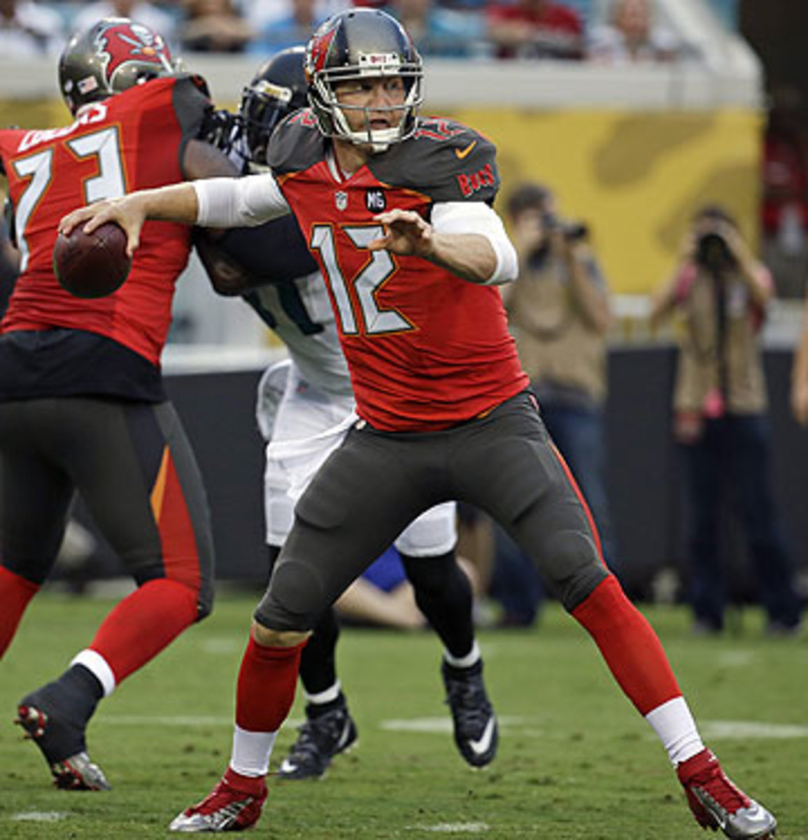 Josh McCown has looked good at camp, but did not play well—two turnovers—in the Bucs' first preseason game. (John Raoux/AP)