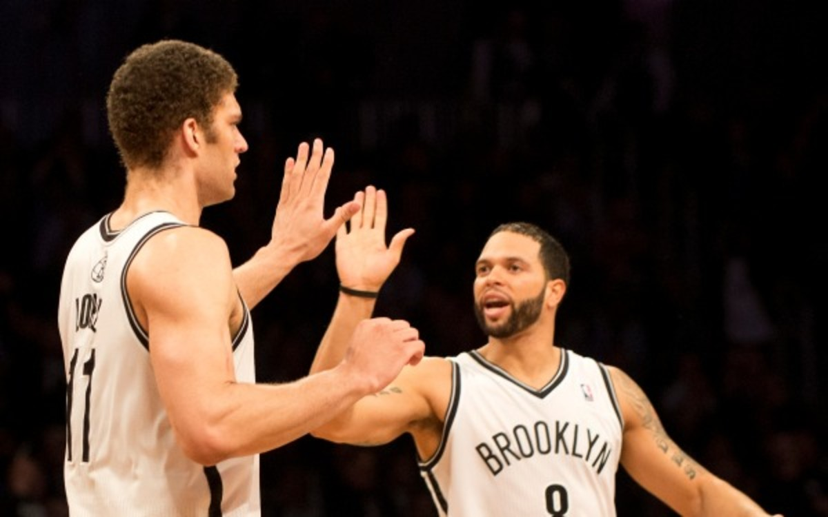 Brook Lopez and Deron Williams have dealt with injury problems all season. (Don Emmert /AFP/Getty Images)