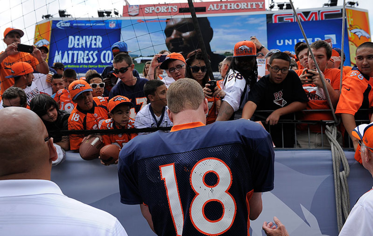 Denver fans were out in force to see No. 18 and the Broncos go through training camp practices. (John Leyba/Getty Images)