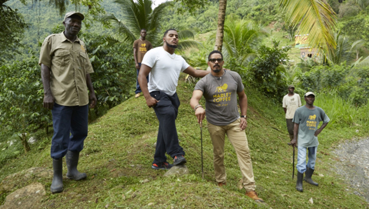 With his son, Nico (in white) in mind, Rohan (in sunglasses) built a flourishing coffee business on the his 52-acre farm.