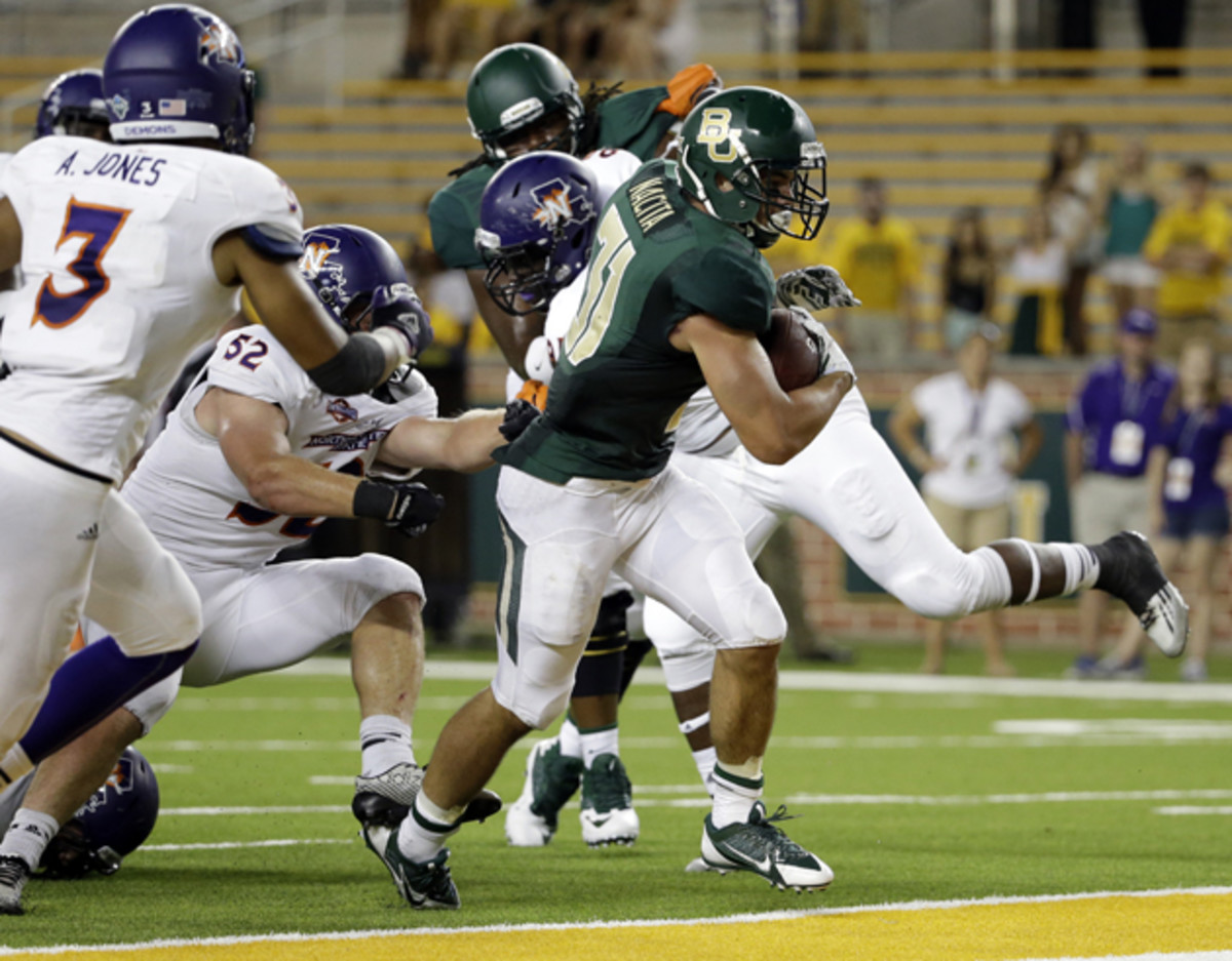 Nacita (31) fights his way into the end zone for a score late in the second half of a Baylor-Northwestern State game in September.