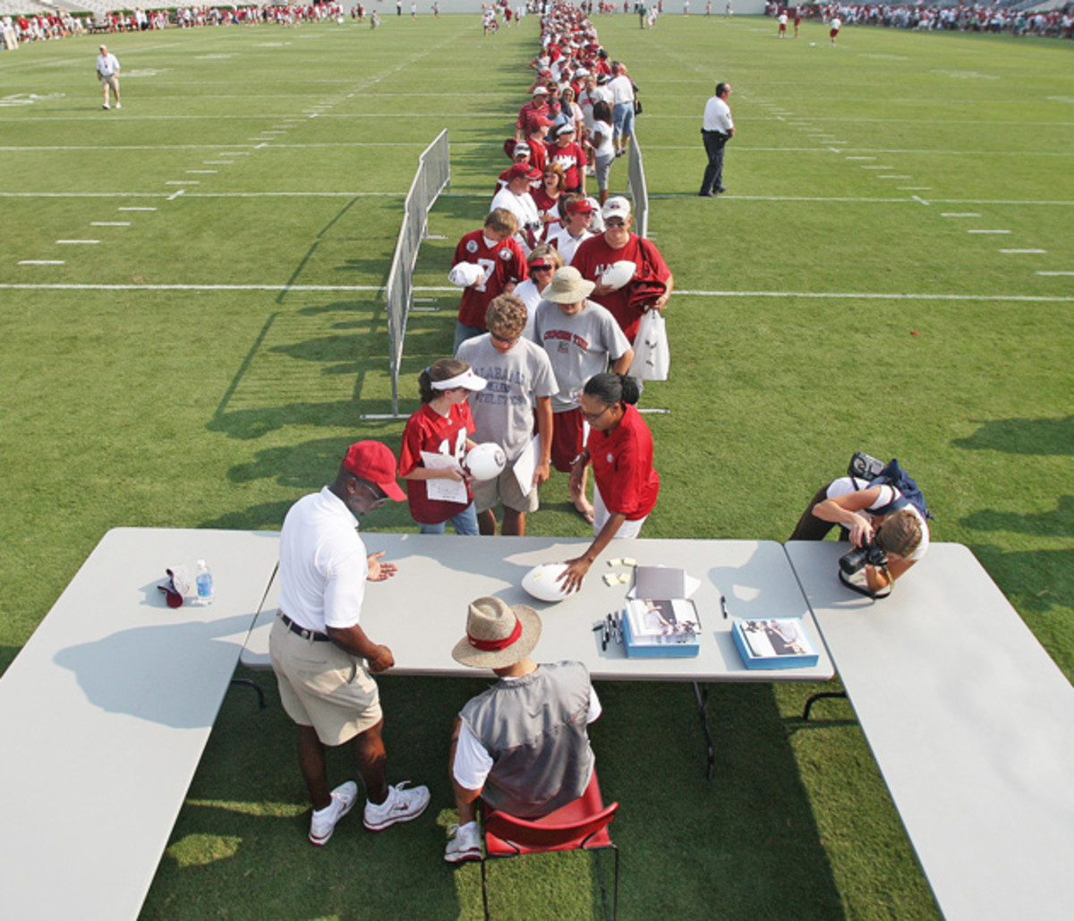 Alabama fans young and waited in line to get Saban's autograph after an early August practice.