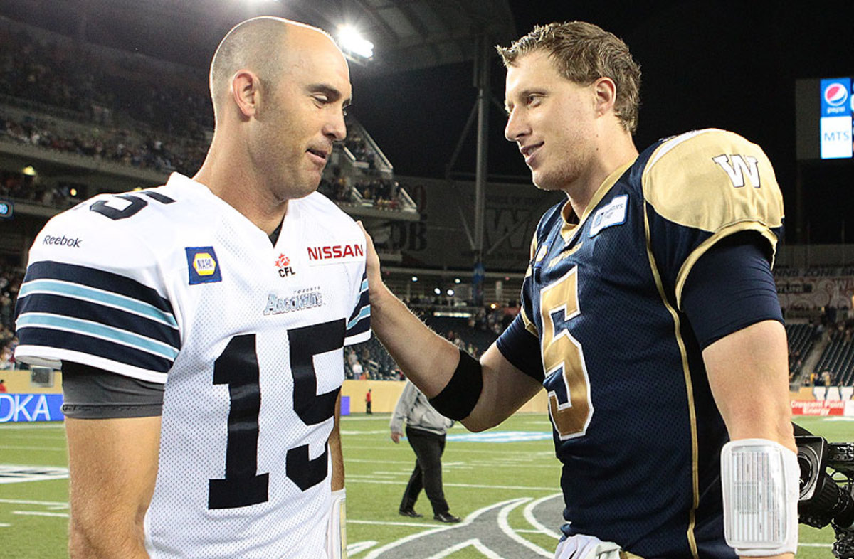 Ricky Ray (left) is a long-time CFL star, but it was first-time starter Drew Willy who shined on CFL's opening night. (Marianne Helm/Getty Images)