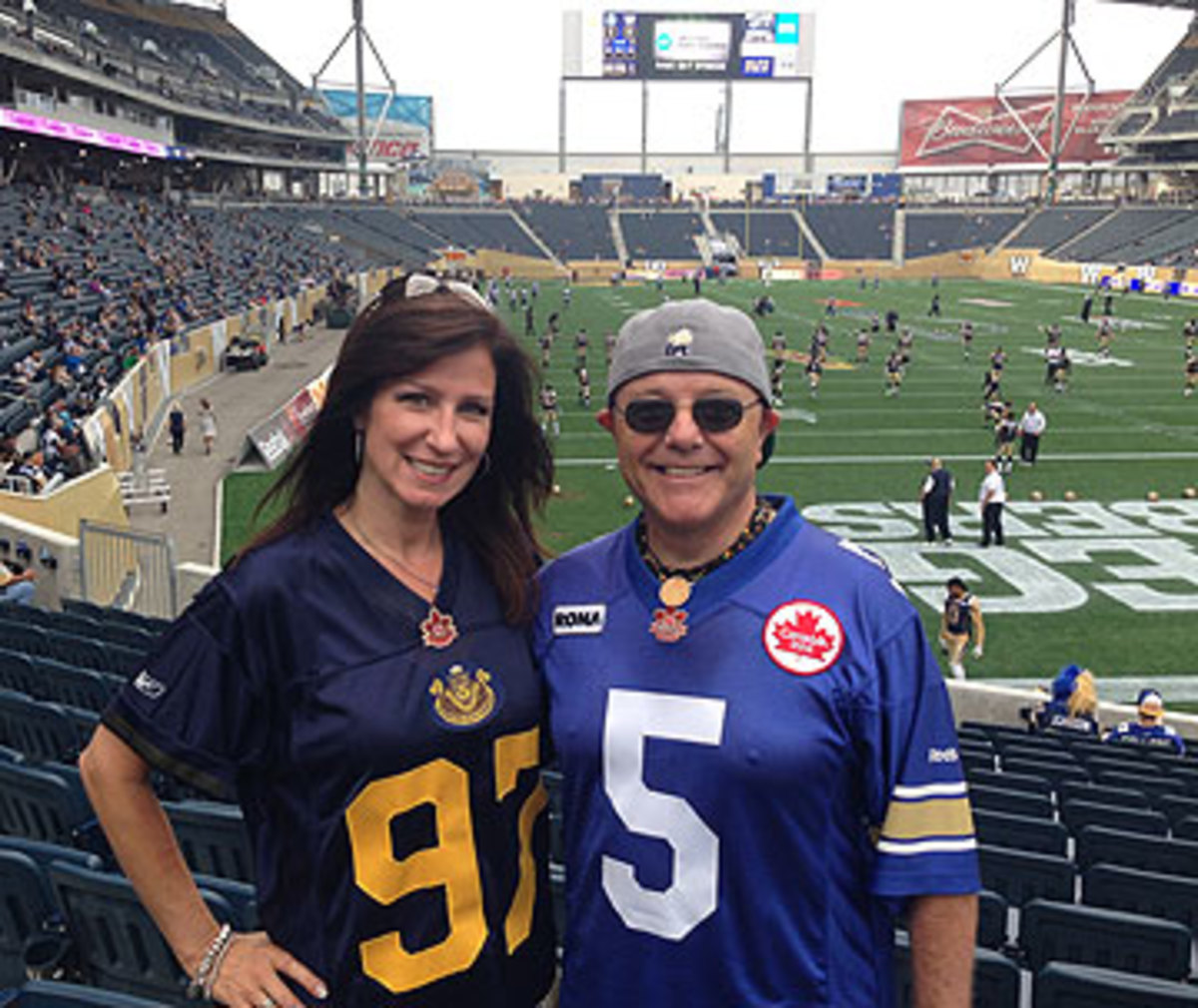 Becky Kaufmann and Chuck Duboff have had Bombers tickets in their families for more than 50 years each. (Photo by Jenny Vrentas)