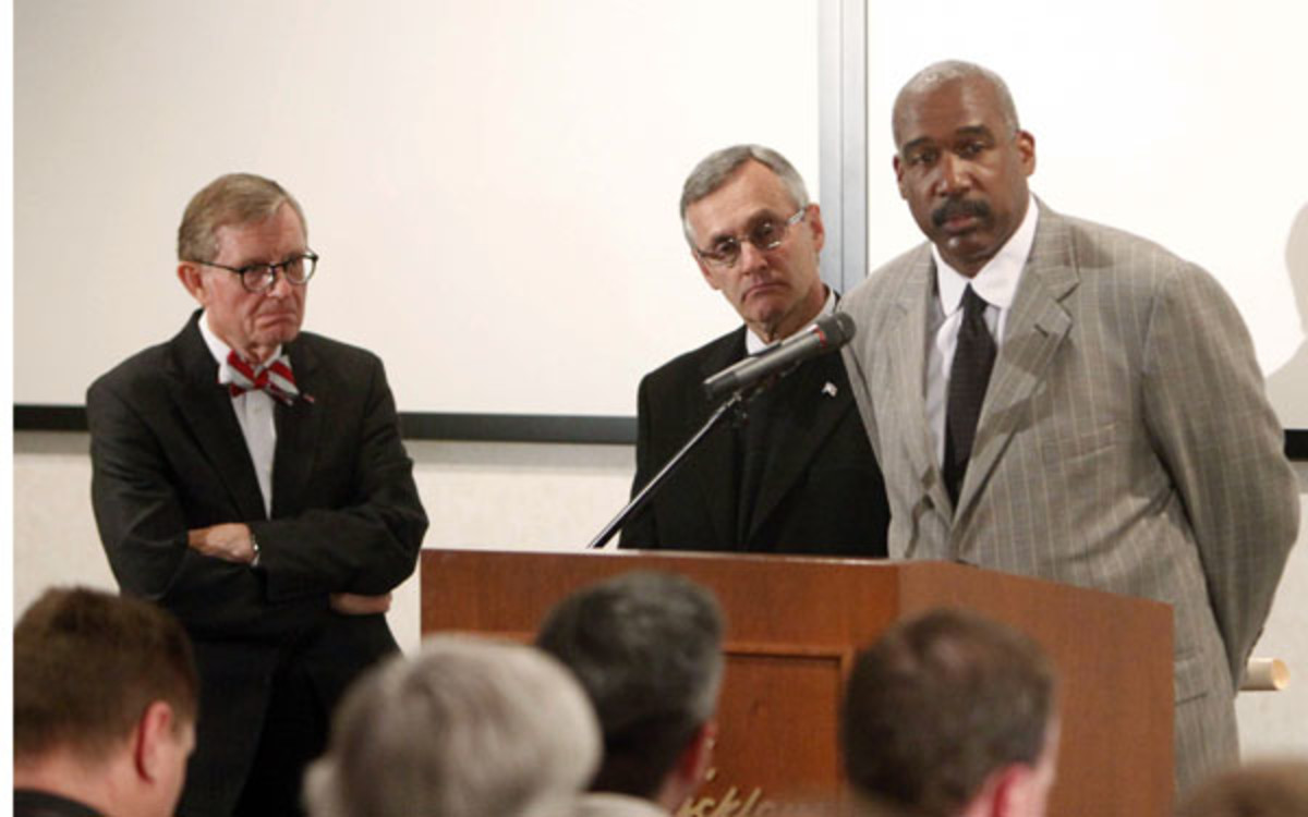 Former OSU staffers Jim Tressel, Gordon Gee and AD Gene Smith face questions about NCAA violations. (AP Photo/Terry Gilliam,