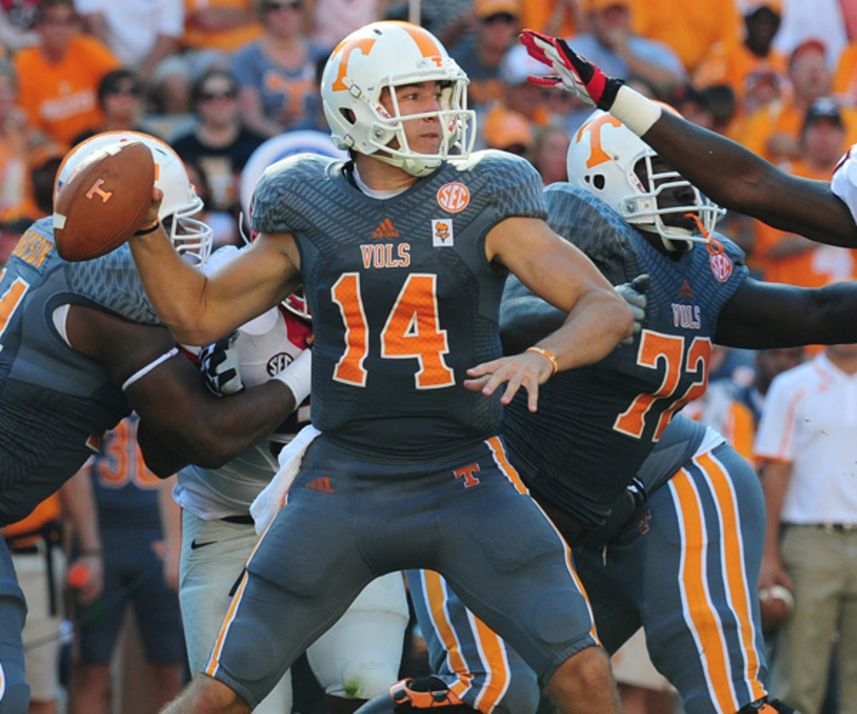 """Justin Worley #14 of the Tennessee Volunteers in the adidas-designed """"smokey gray"""" uniform in 2013. (Photo by Scott Cunningham/Getty Images)"""
