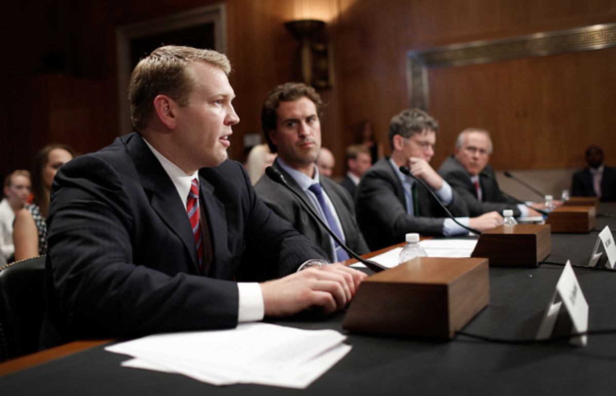 Chris Nowinski, left, is at the forefront of the concussion education and reform movement, pictured above speaking at a June U.S. senate hearing.