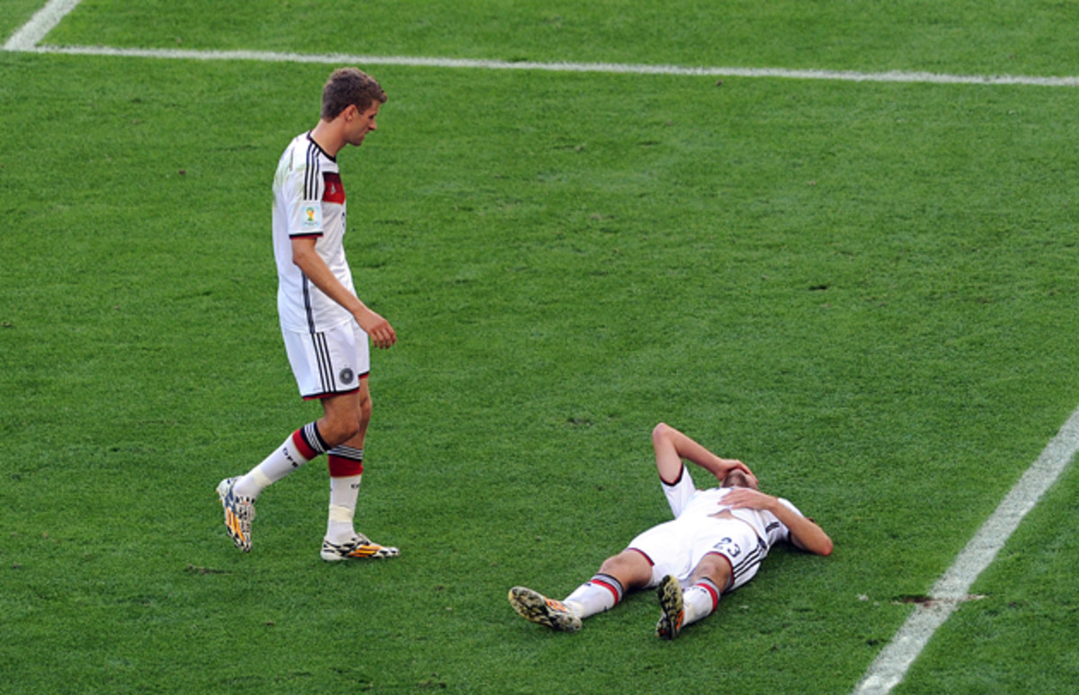Germany's Christoph Kramer, right, suffered a concussion in the World Cup final and says he can't remember what happened in the match.