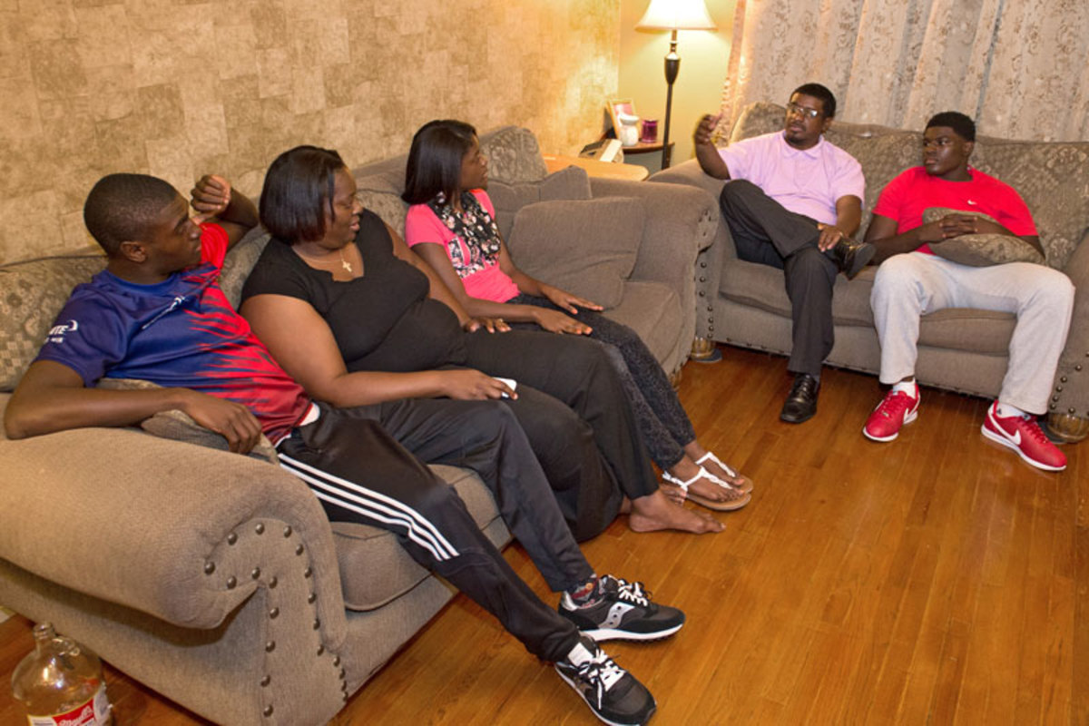 The Spraggins family (Kevin III is at far left) at home on Monday, discussing the events enveloping their town.