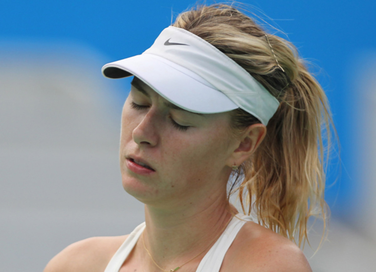 Sharapova reacts after her loss to Bacsinszky.