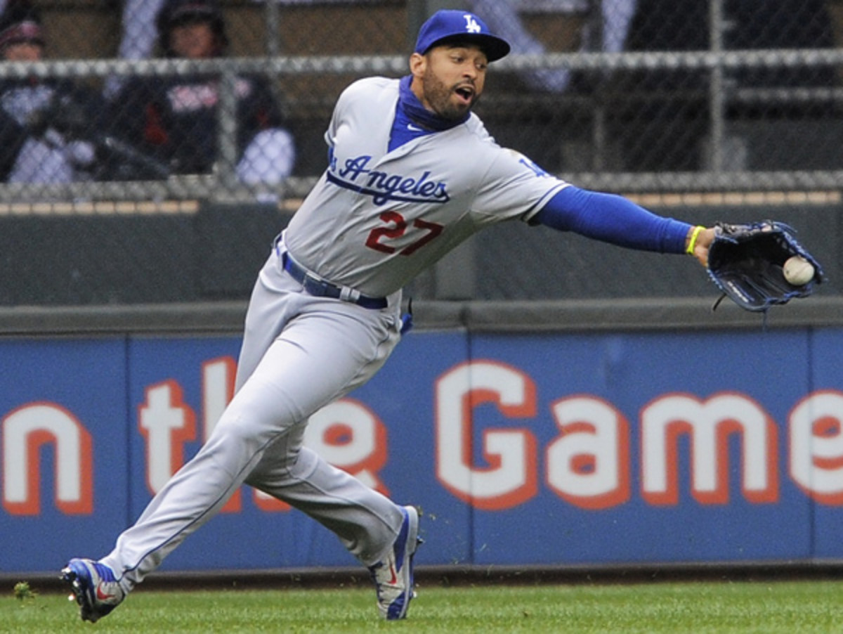Matt Kemp has spent the last five games on the bench for the Dodgers. (Tom Olmscheid/AP)