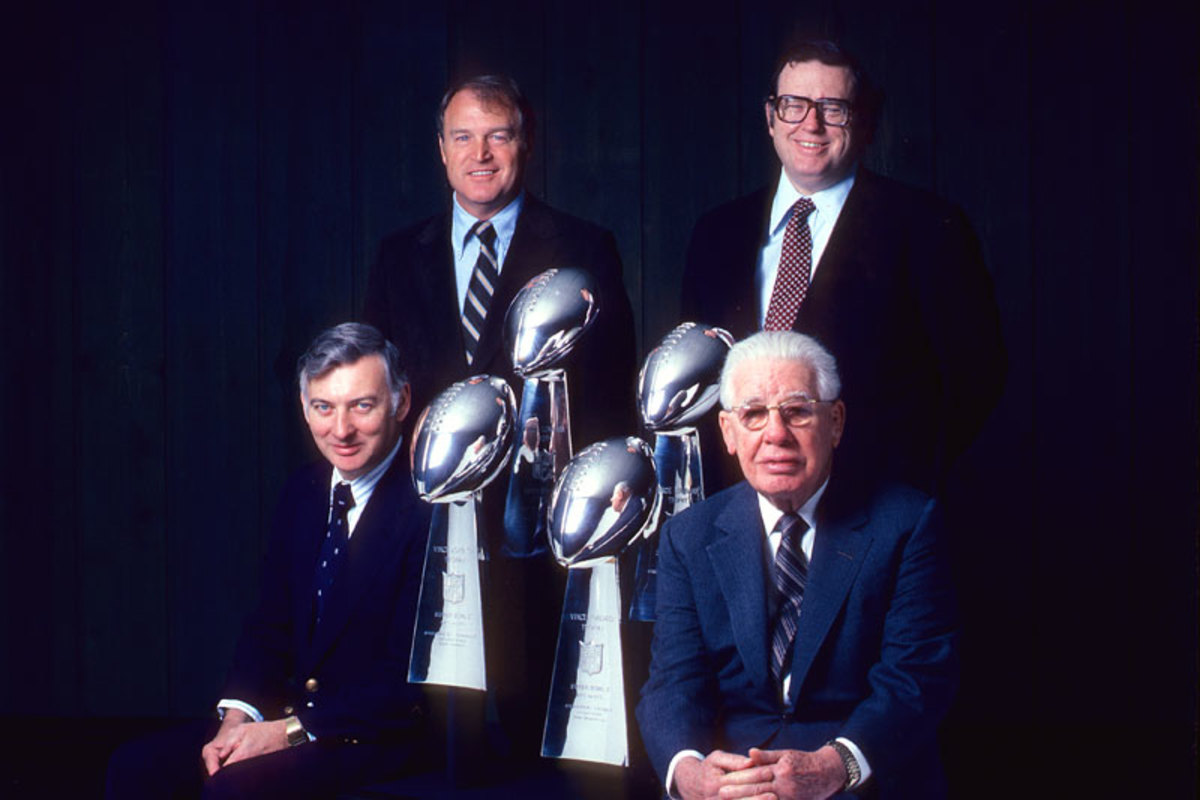A 1982 portrait of Steelers front office (l. to r.) team president Dan Rooney, coach Chuck Noll, team vice president Art Rooney Jr., and owner and chairman Art Rooney Sr. (John G. Zimmerman/SI)