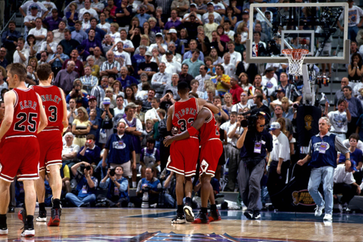 """Michael Jordan gets helped off the court by Scottie Pippen during Jordan's infamous """"Flu Game"""" during the 1997 NBA Finals against the Utah Jazz. Grover maintains that he believes Jordan was poisoned, """"I've never seen a flu hit that quickly."""""""