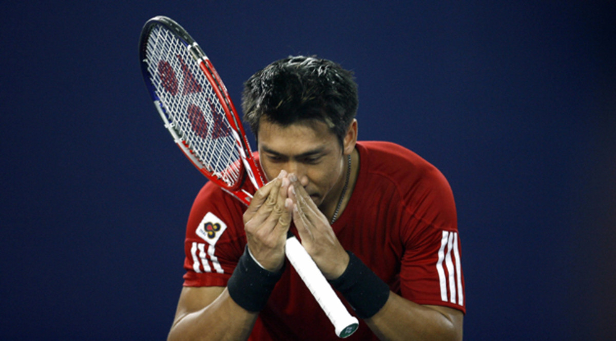 """Srichaphan gives his traditional """"wai,"""" or bow to the crowd, after a match in Beijing in 2006."""