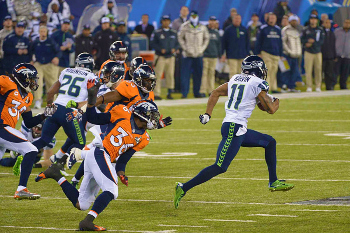 The collapse extended to special teams, which got overaggressive on the opening kickoff of the second half; Harvin took it to the house to make the score 29-0. (John Iacono/Sports Illustrated/The MMQB)