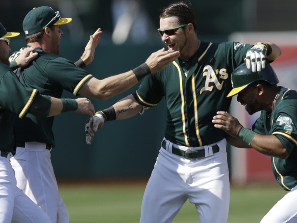 Josh Reddick (center) and the A's have won eight of their last 10, including a weekend sweep of the Astros.