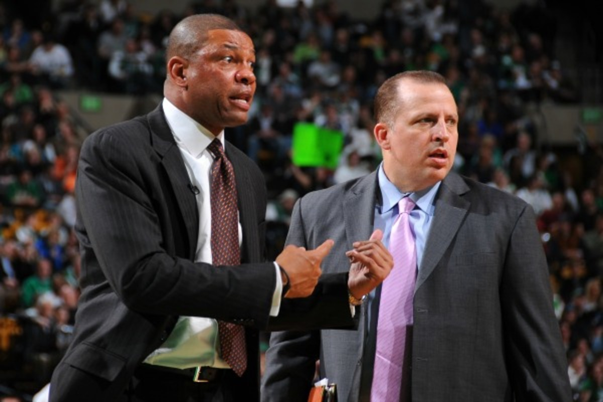 Tom Thibodeau (right) worked under Doc Rivers (left) with the Celtics. (Steve Babineau/Getty Images)