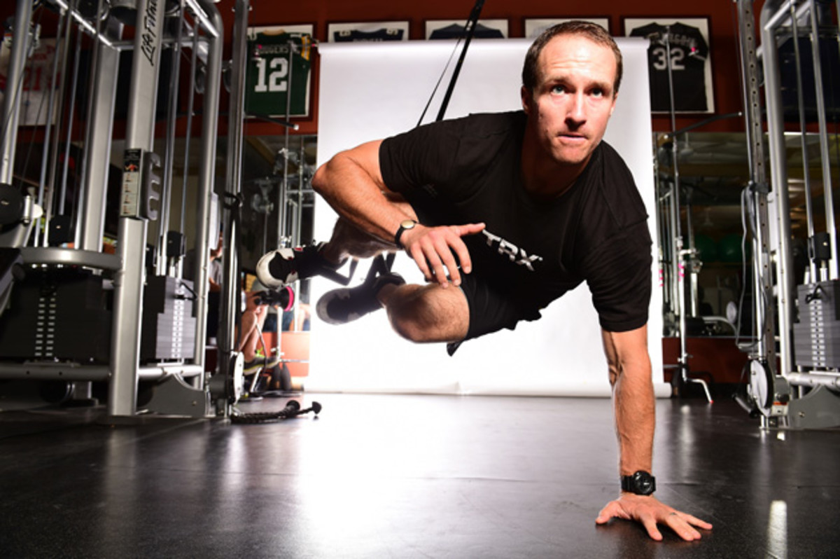 """ONE-ARMED CATAPULT: Having his feet elevated creates an """"unstable environment,"""" says Brees, forcing other muscle groups to work overtime. Do not try this one at home—experts only, please!"""