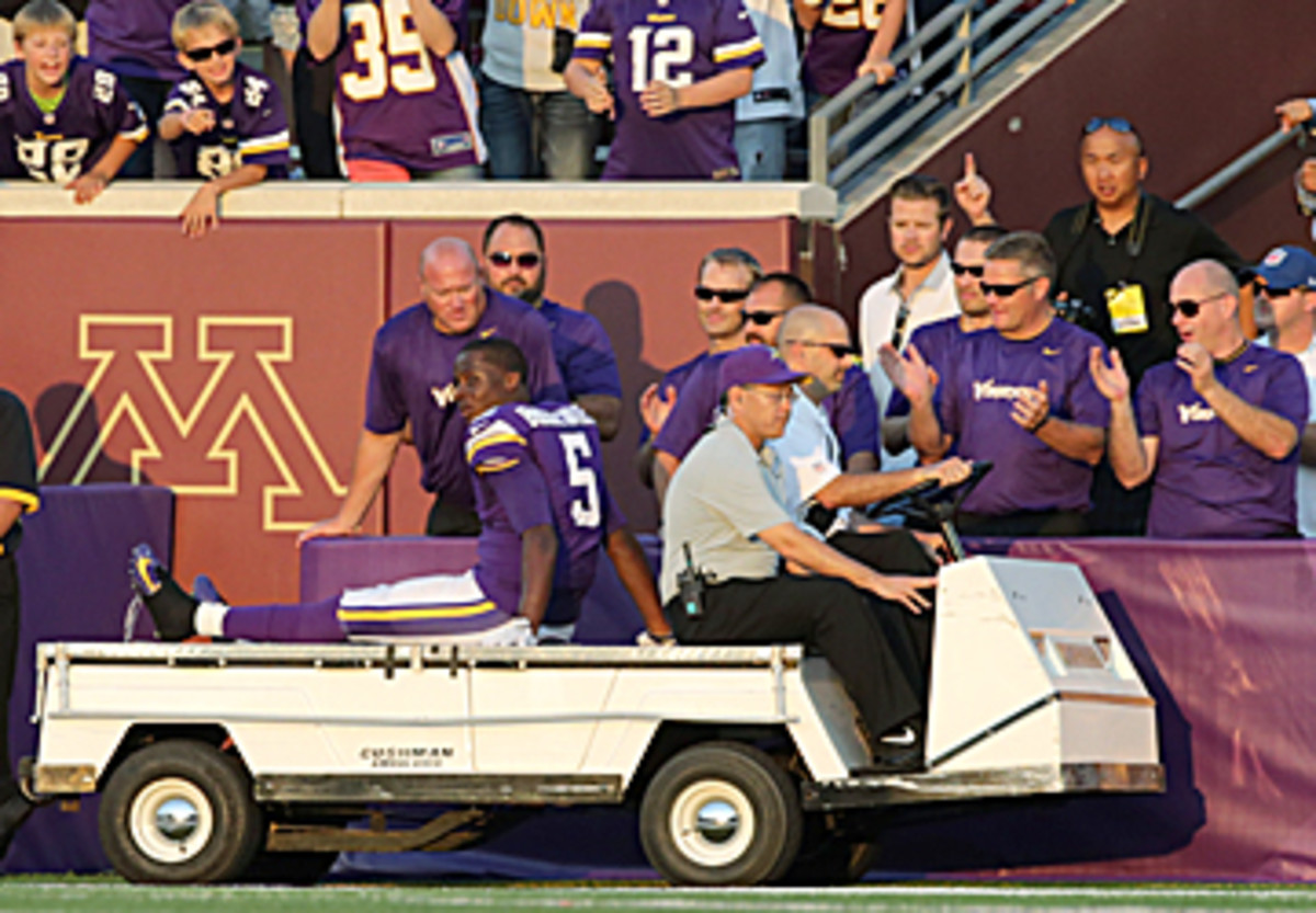 Bridgewater was carted off with an ankle injury in the fourth quarter, but not before he had put the Vikings in position for the win. (Jim Mone/AP)