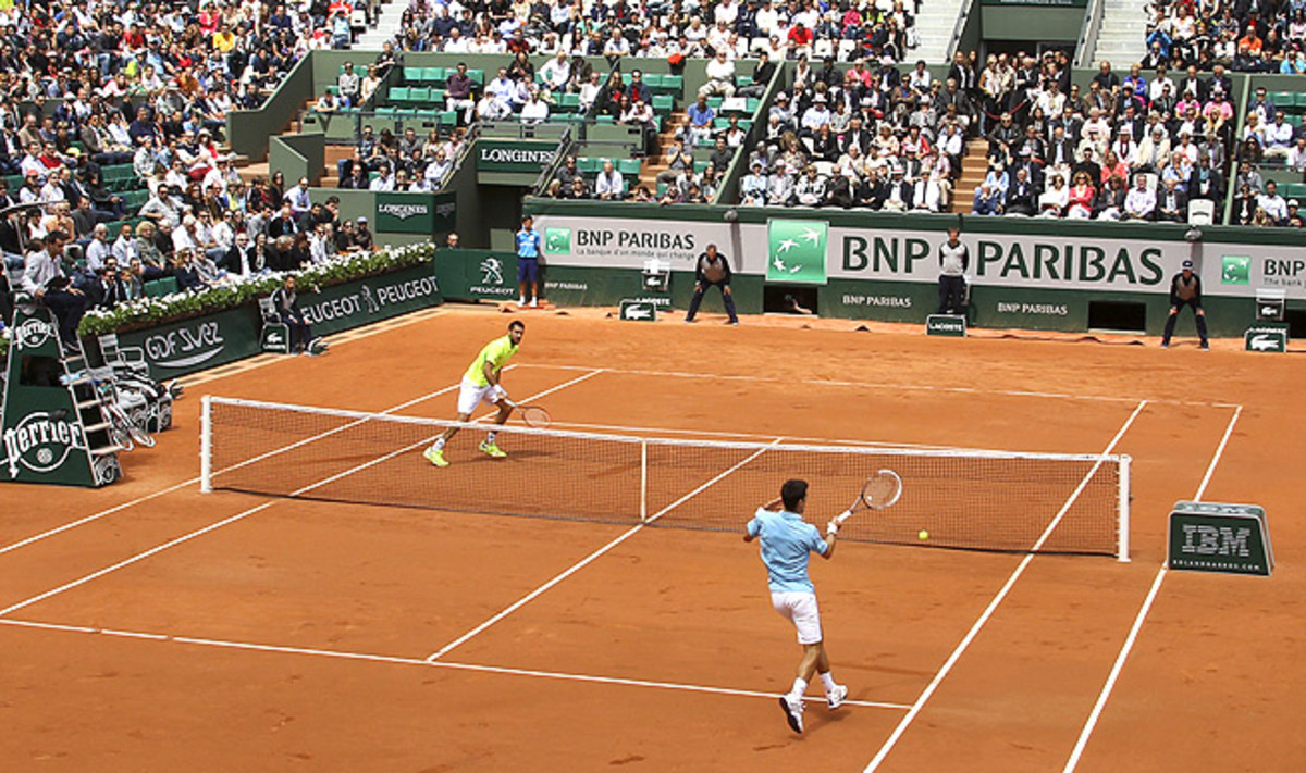 Novak Djokovic (right) dropped his first set of the French Open against Marin Cilic in the third round.