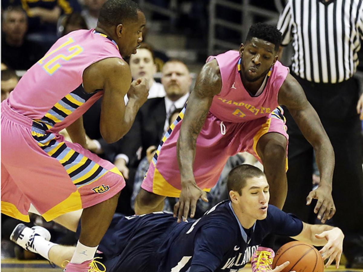 Villanova's Ryan Arcidiancono (center) made several critical plays against Marquette. (Jeffrey Phelps/AP)
