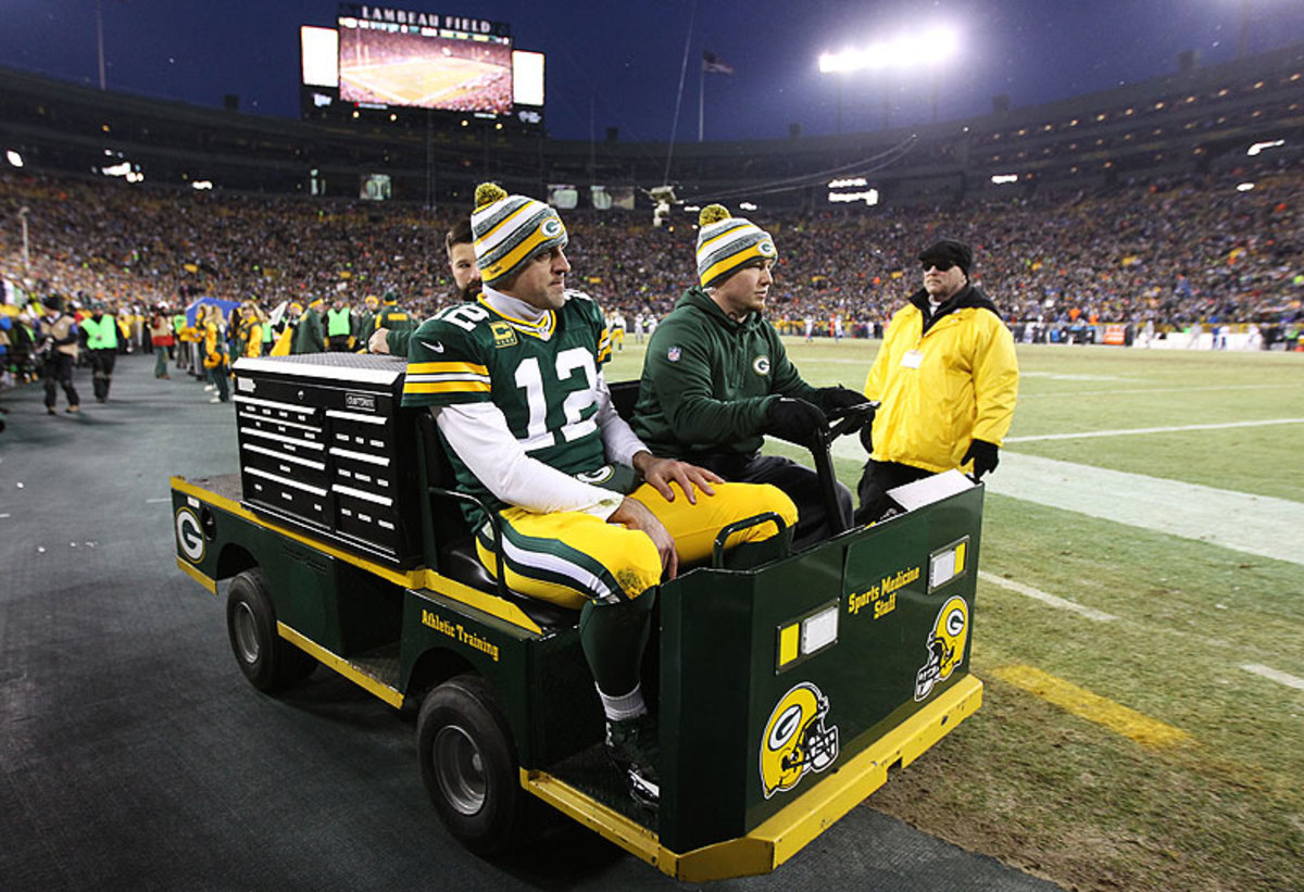 Aaron Rodgers was carted into the locker room with a calf injury Sunday, but he returned to help lead the Packers to the NFC North title. (Chris Graythen/Getty Images)