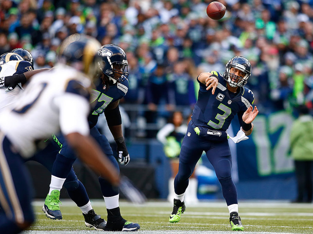 For the second straight season, Russell Wilson and the Seahawks enter the postseason as the NFC's No. 1 seed. (Jonathan Ferrey/Getty Images)