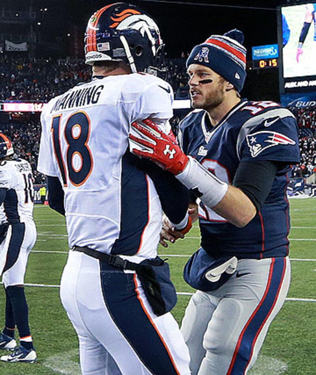 Tom Brady and Peyton Manning will meet again in 2015 since their teams each won their divisions this season. (Jim Davis/Getty Images)