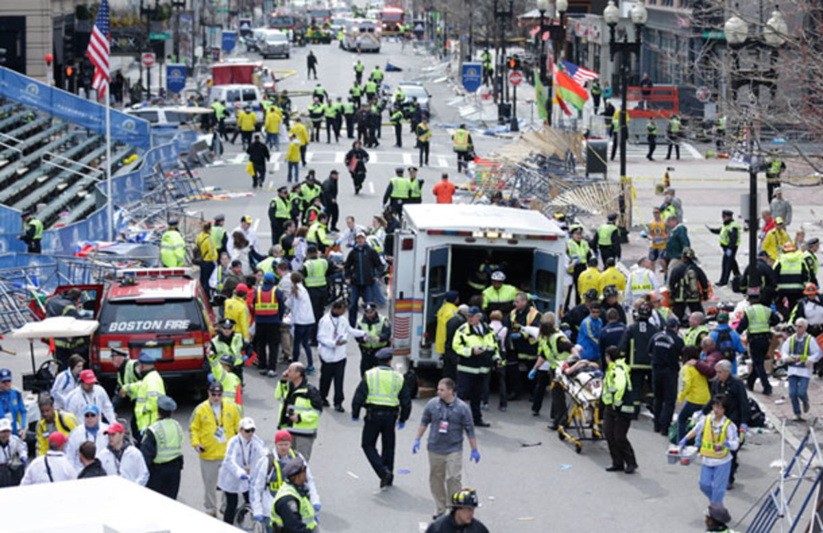 Emergency crews are helping the injured after two explosions were heard as runners finished the Boston Marathon. (Charles Krupa/AP)
