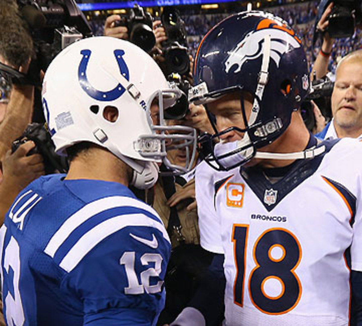 Andrew Luck and Peyton Manning meet again in Week 1. (Andy Lyons/Getty Images)