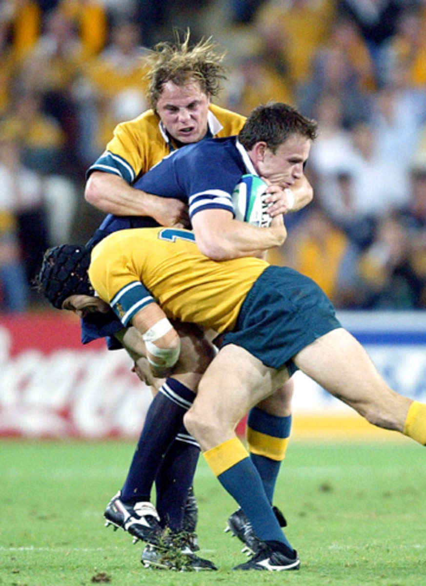 To emphasize shoulder tackling, there are Rugby clips sprinkled in throughout the video.(Christophe Simon/AFP/Getty Images)