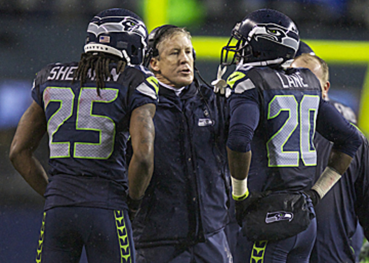 The technique taught by Carroll and his staff has allowed Seattle to maintain one of the league's most physical defenses. (Stephen Brashear/Getty Images)