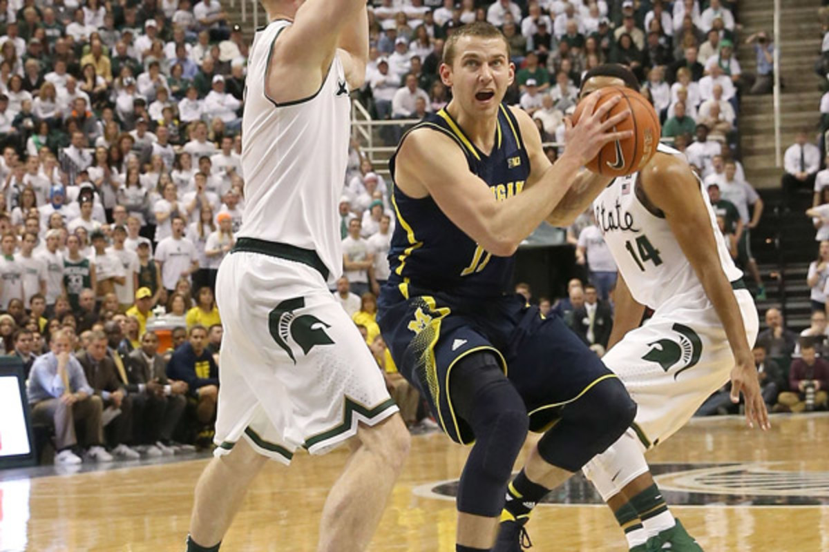 Nik Stauskas once again came up big for the Wolverines with a key tie-breaking trey against the Spartans. (Leon Halip/Getty Images)