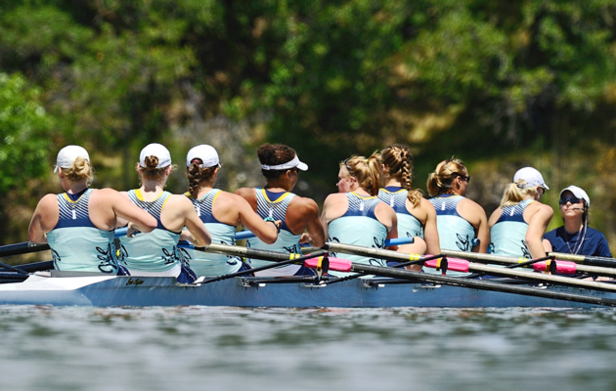 Jill Costello (right, in navy) coxes the top women's boat, all wearing special turquoise unis in honor of Jill, in the 2010 NCAA championships.