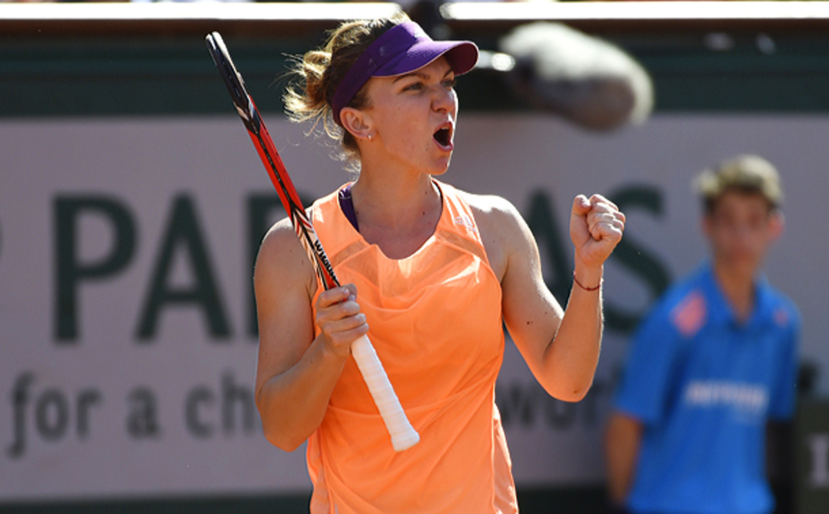 Simona Halep celebrates after taking the second-set tiebreaker. (PASCAL GUYOT/AFP/Getty Images)