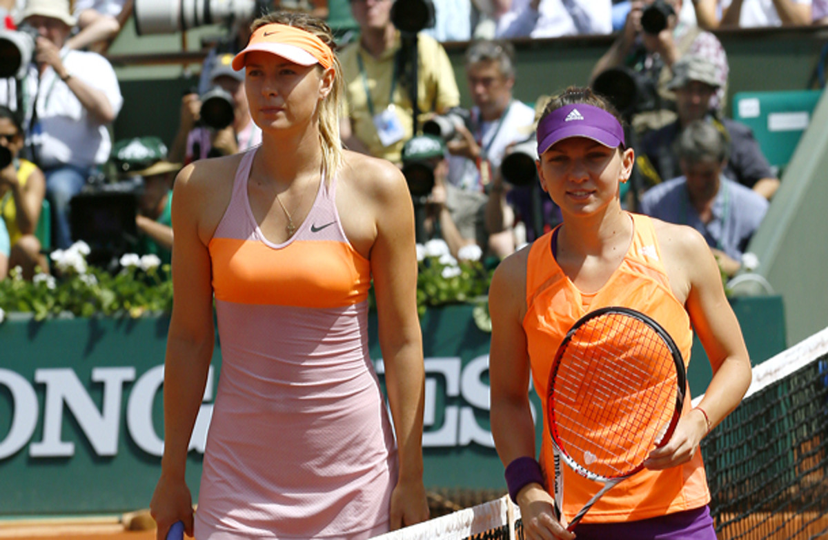 Maria Sharapova didn't even attempt a smile in the prematch photo with Simona Halep. (PATRICK KOVARIK/AFP/Getty Images)