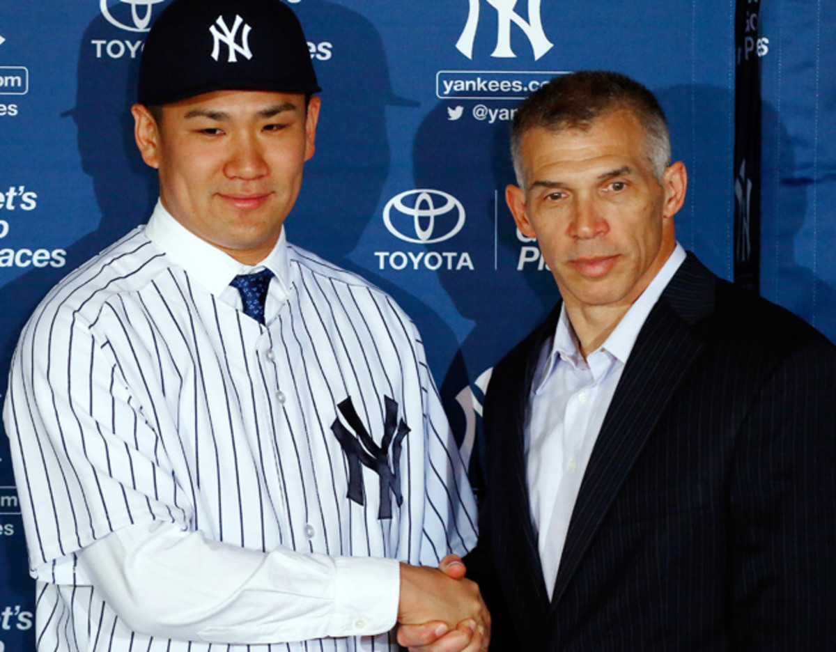 Masahiro Tanaka shakes hands with Joe Girardi during his introductory press conference in January.