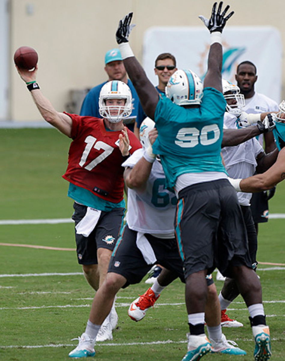 Playing behind a new offensive line is one of the challenges facing Ryan Tannehill as he enters his third season. (Alan Diaz/AP)