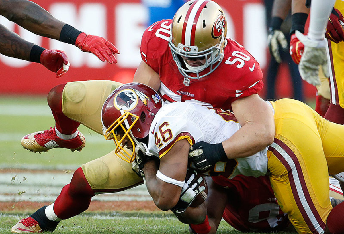 Chris Borland is averaging 12.8 tackles per game since taking over as a starting inside linebacker five weeks ago. (Tony Avelar/AP)