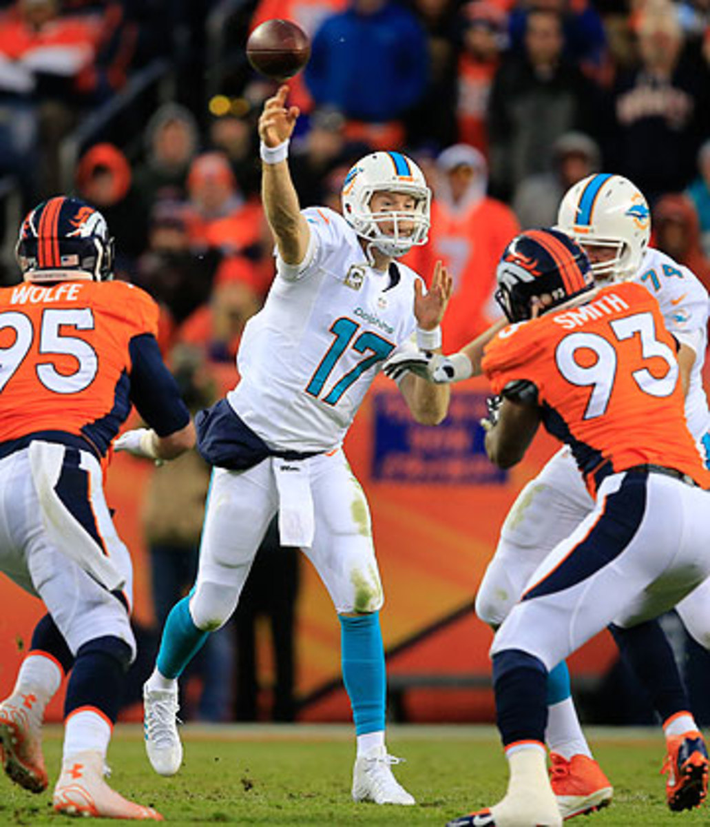 Ryan Tannehill stood tall against the Broncos, but the 6-5 Dolphins still face an uphill climb to make the postseason. (Doug Pensinger/Getty Images)