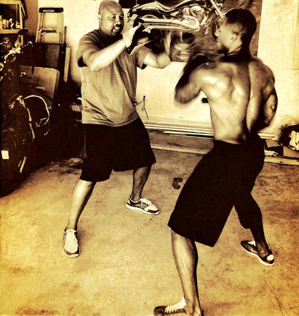 Philadelphia Eagles cornerback Brandon Boykin working out with his trainer.