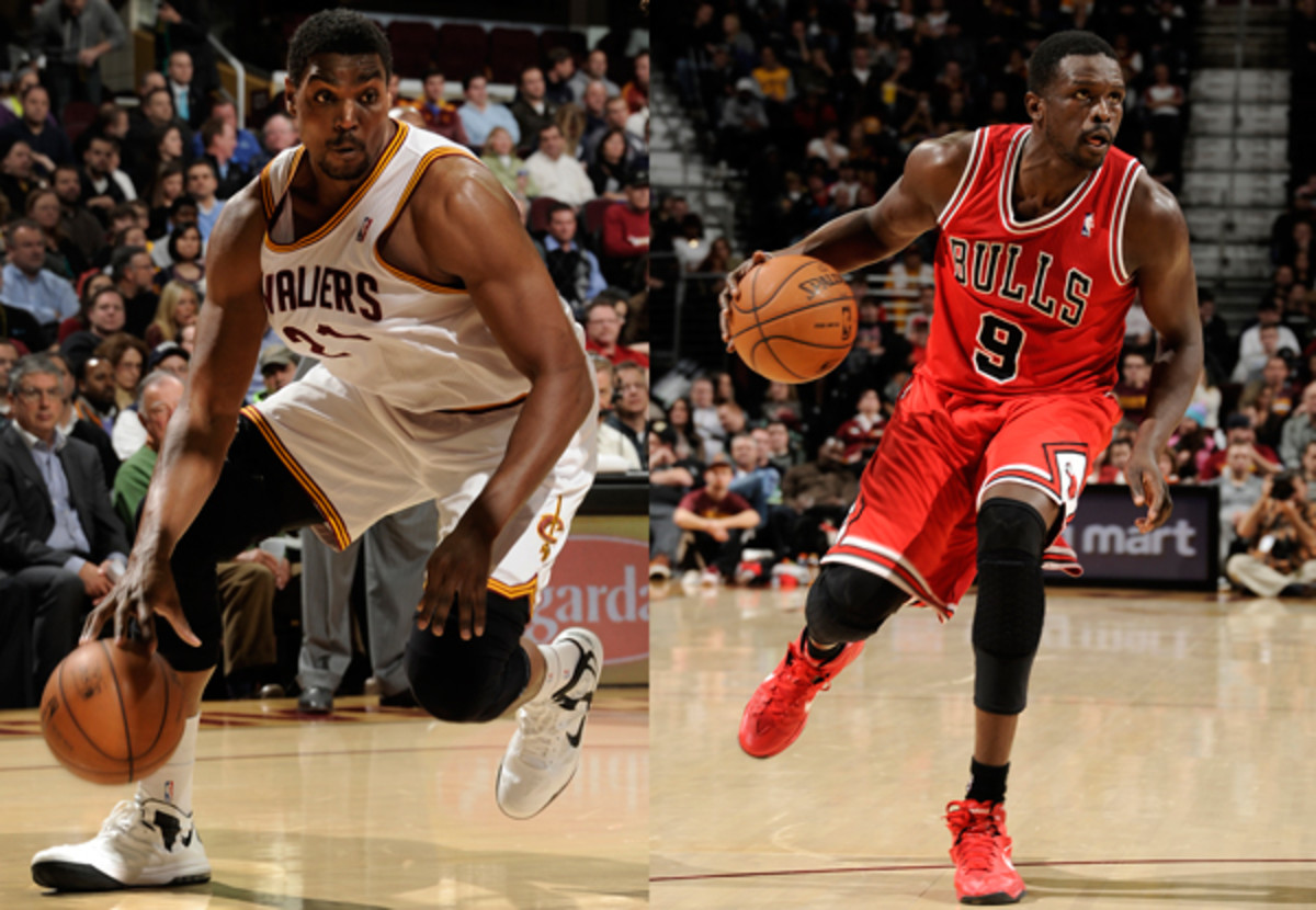 Cavaliers center Andrew Bynum (left) was traded to the Bulls for forward Luol Deng (right). (David Liam Kyle/Getty Images)