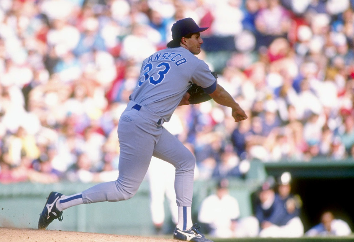 Jose-Canseco-pitching.jpg