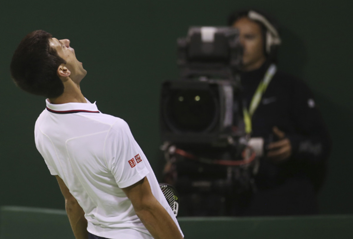 Djokovic reacts after losing a point to Karlovic in Doha.